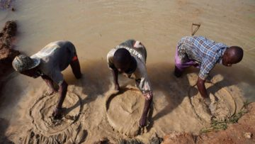 FILE PHOTO: Artisanal miners pan for diamonds, which fuelled the 1991-2002 civil war, in the town of Koidu in eastern Sierra Leone