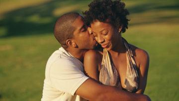 black-couple-squeeze-field